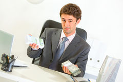 Authoritative businessman sitting at desk Royalty Free Stock Photo