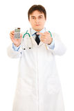 Authoritative doctor pointing finger on calculator Royalty Free Stock Photos