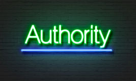 Authority neon sign on brick wall background. Authority neon sign on brick wall background Stock Photo