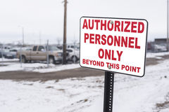 Authorized personell only sign by locked compound Stock Photo