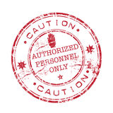Authorized personnel only. Abstract red grunge rubber stamp with hand shape and the text caution authorized personnel only written inside the stamp royalty free illustration
