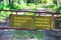 Authorized vehicles only sign in both french and english Stock Photo