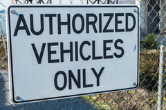 Authorized vehicles  only sign on steel fence Stock Photos