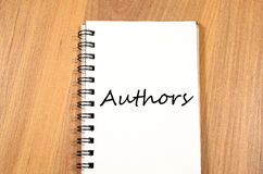 Authors write on notebook Royalty Free Stock Photos