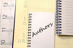 Authors write on notebook Royalty Free Stock Photography