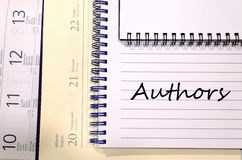 Authors write on notebook Royalty Free Stock Image