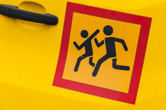 Сaution children transportation sign. Square yellow Сaution children transportation sign in red frame, sticker on school minivan door Stock Image