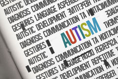Autism against open book Stock Photos