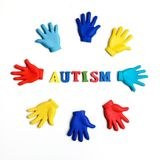 Autism awareness concept with colorful hands on white background. Top view. Autism awareness concept with colorful hands on white background Royalty Free Stock Images