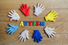 Autism awareness concept with colorful hands on wooden background. Top view. Autism awareness concept with colorful hands on wooden background Stock Image