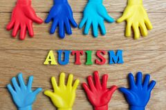 Autism awareness concept with colorful hands on wooden background. Top view. Autism awareness concept with colorful hands on wooden background Royalty Free Stock Photography