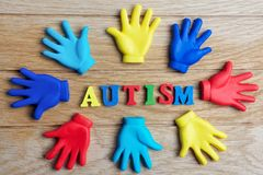 Autism awareness concept with colorful hands on wooden background. Top view. Autism awareness concept with colorful hands on wooden background Royalty Free Stock Image