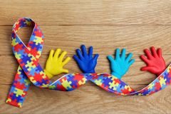 Autism awareness concept with colorful hands on wooden background. Top view. Autism awareness concept with colorful hands on wooden background Stock Photos