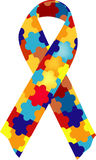Autism Awareness Ribbon. A puzzle patterned ribbon symbolizing autism awareness Royalty Free Stock Images