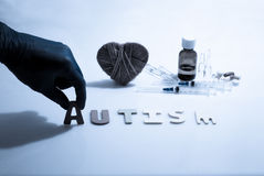 Autism. Hand and autism word on the white background Stock Photo
