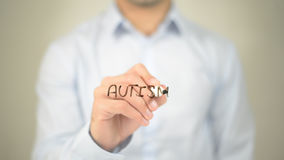 Autism, man writing on transparent screen. High quality Stock Photography