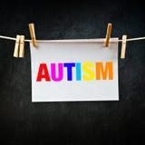 Autism som skrivs ut på papper Arkivbild