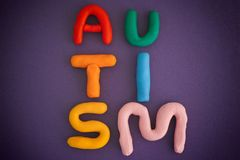 Autism spectrum disorder. Autism. Autism spectrum disorder. Autism word made out of playdough. Purple background. Close up Royalty Free Stock Photos