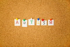 Autism stuck on cork board. Shot in studio Royalty Free Stock Photo