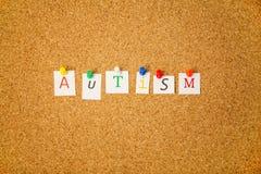 Autism stuck on cork board Royalty Free Stock Photo