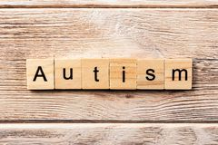 Autism word written on wood block. autism text on table, concept.  royalty free stock photography