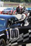 Autista di macchina da corsa Immagini Stock
