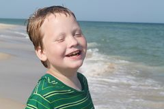 Autistic Boy Enjoying the Beach Royalty Free Stock Image