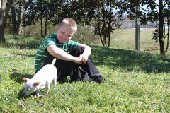 Autistic Boy With His Dog Royalty Free Stock Photography