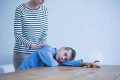 Autistic boy laying on a table Royalty Free Stock Images
