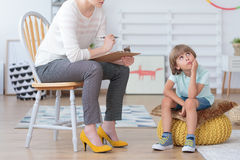 Autistic boy during psychotherapy consultation Stock Photos