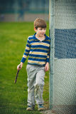 Autistic Boy with Stick Royalty Free Stock Images