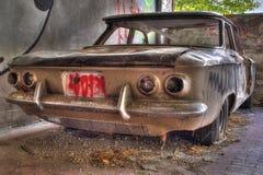 Auto abbandonata retro. Car abandoned inside of a factory outside Bologna Royalty Free Stock Image