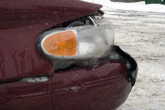 Auto Accident. A side view of a front end collision near the headlight.  The fender, bumper, hood, and light are all damaged Stock Images