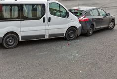 Auto accident involving two cars. On a city street royalty free stock images