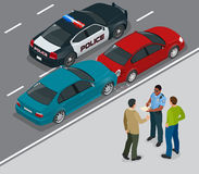 Auto accident involving two cars on a city street. Traffic policeman in car accident scene. Two Drivers Arguing After Royalty Free Stock Image