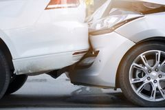 Auto accident involving two cars on a city street. Two cars crashed stock images