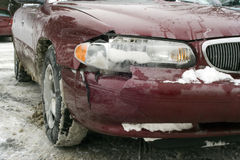 Auto Accident in Winter. Front End collision during the winter caused damage to bumper, hood, headlight, and fender Royalty Free Stock Image