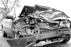 Auto Accidents. A wrecked car lays in wait after a vicious car accident Royalty Free Stock Image