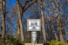 Auto air pump in front of trees Stock Photography