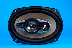 Auto audio system loud speaker. For car isolated on blue Stock Images