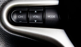 Auto Audioknopen op Stuurwiel Stock Foto