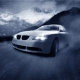 Auto in beweging Royalty-vrije Stock Afbeeldingen
