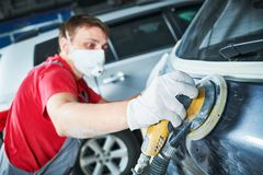 Auto repairman grinding autobody Royalty Free Stock Photo