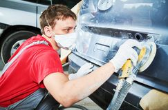 Auto repairman grinding autobody Stock Images