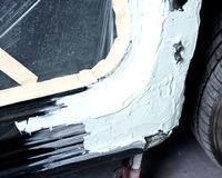 Auto body work. Body shop, after filler car is just ready for sanding and repainting Stock Images