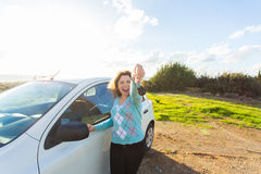 Auto business, car sale, consumerism and people concept - happy woman holding new car key outdoor.  Royalty Free Stock Photos
