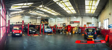 Auto car repair shop. / garage workshop with cars Stock Photography