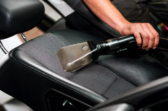 Auto car service cleaning the drivers seat Royalty Free Stock Photography