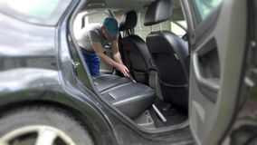 Auto car service cleaning seat, cleaning and vacuuming. Leather stock video footage
