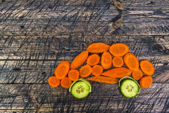 Auto car vehicle vegetable early board wooden carrots cucumber l Royalty Free Stock Photos